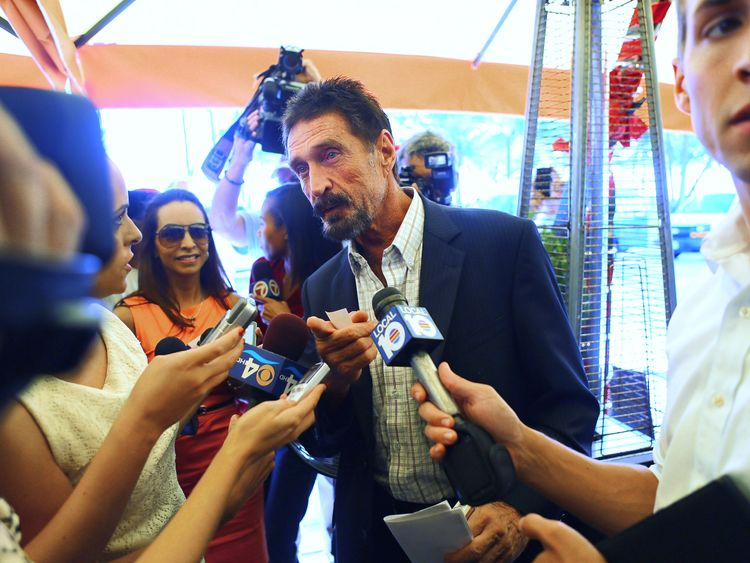 "MIAMI BEACH, FL - DECEMBER 13:  John McAfee talks to the media outside Beacon Hotel where he is staying after arriving last night from Guatemala on December 13, 2012 in Miami Beach, Florida. McAfee is a ""person of interest"" in the fatal shooting of his neighbor in Belize and turned up in Guatemala after a month on the run in Belize.  (Photo by Joe Raedle/Getty Images)"