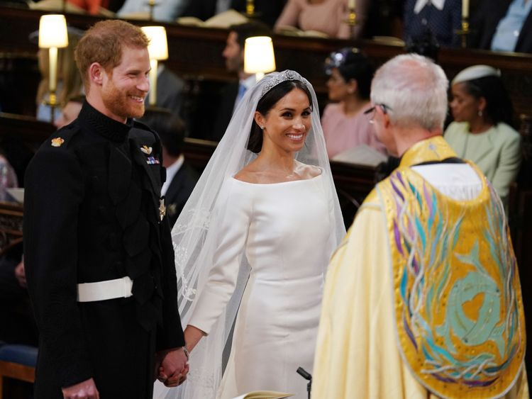Prince Harry and Meghan Markle smile during the ceremony