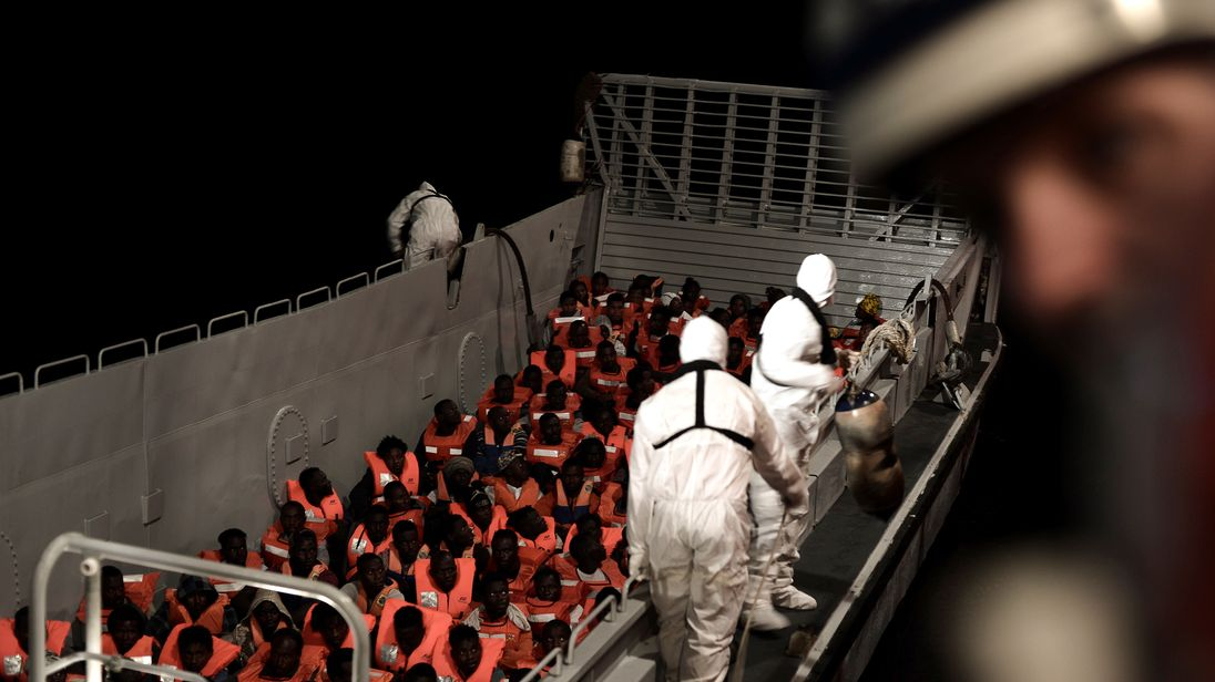 Migrants are rescued by staff members of the MV Aquarius on 10 June