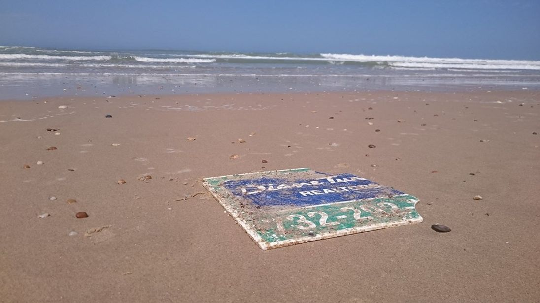 US sign washes up on French beach