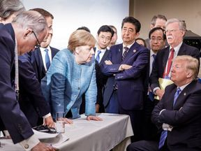 A photo shared on Angela Merkel's official Instagram account hints at tension among G7 leaders