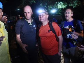 Richard William Stanton (2nd-L), Robert Charles Harper (3rd-L) and John Volanthen (R) arrive at the caves