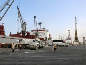 A crane unloads food aid provided by UNICEF at the Red Sea port of Hodeida