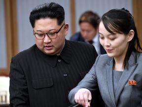 Kim Jong Un with his sister Kim Yo Jong