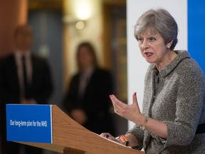 Theresa May announced plans to give the NHS £20bn more