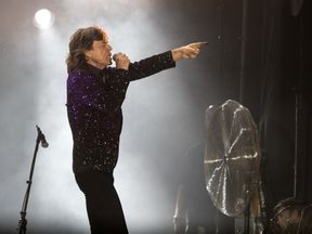 Mick Jagger, the lead singer of British rock group The Rolling Stones, performs on stage at Hayarkon Park in the Mediterranean coastal city of Tel Aviv, on June 4, 2014