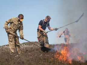 Soldiers from 4 SCOTS have been working with the firefighters to bring the fire on Saddleworth Moor under control