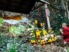 A Thai Buddhist monk prays for 12 boys and their soccer coach, in Mae Sai, Chiang Rai province, northern Thailand