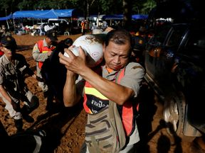 Rescue workers work near Tham Luang cave complex