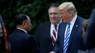 North Korean envoy Kim Yong Chol shakes hands with President Trump at the White House in Washington