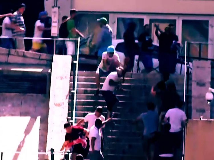 Screen still from Sky News story - man hit over head with chair during violence at 2016 European Championship Final in Marseille.