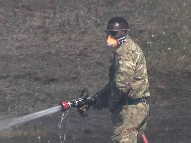 The army is helping firefighters extinguish the fire on Saddleworth Moor