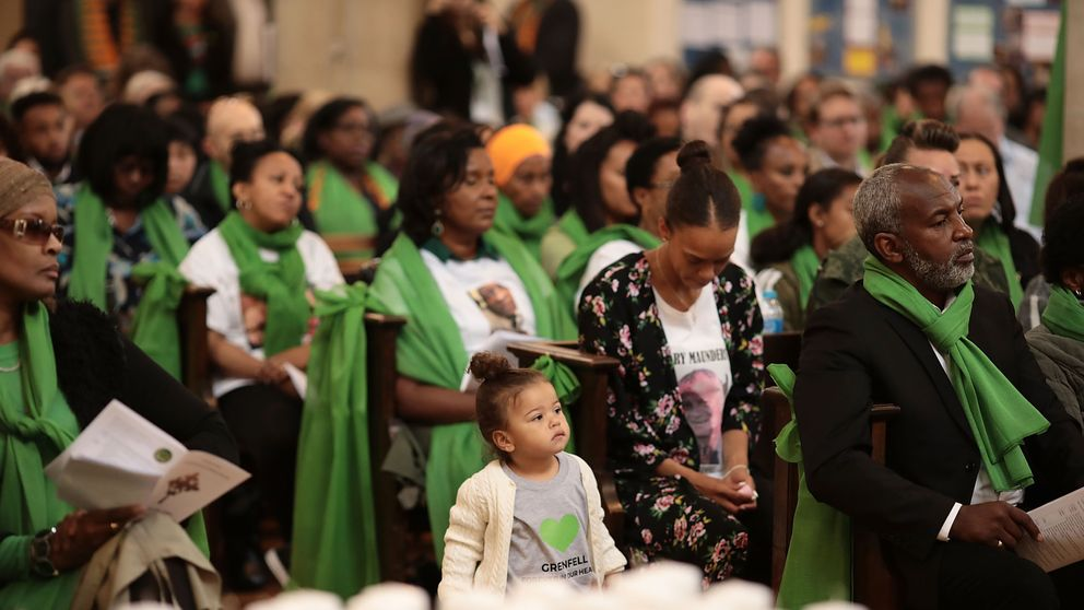 The congregation listen during a memorial service at St Helen's Church
