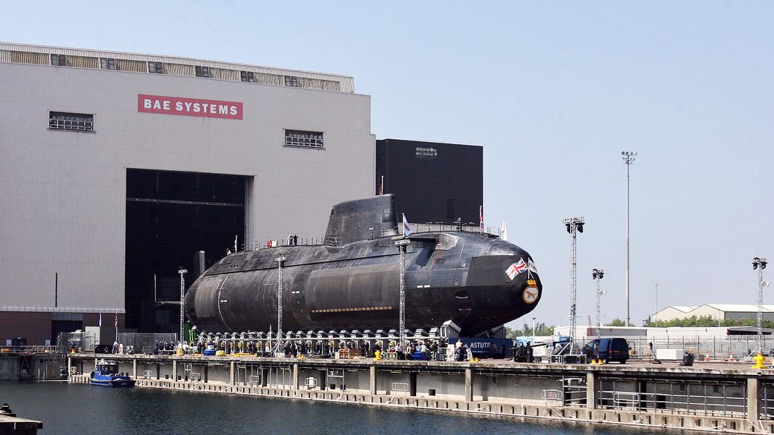 The first Astute class nuclear submarine is brought out of the Devonshire Dock Hall at the BAE Systems production plant in Barrow-in-Furness, north west England, 08 June 2007. The new submarine which is the first of four was named HMS Astute by Camilla, Duchess of Cornwall. Those that follow will be HMS Ambush, HMS Artful and HMS Audacious.