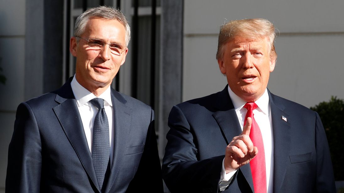 Donald Trump is greeted by NATO Secretary General Jens Stoltenberg before a bilateral breakfast ahead of the NATO Summit in Brussels