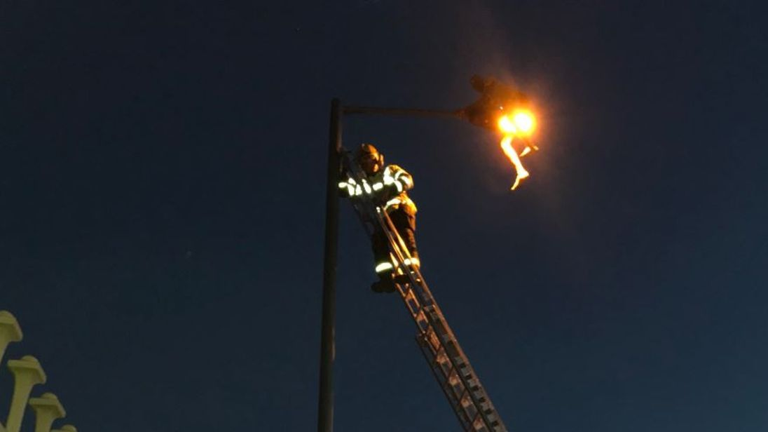 A man was rescued by fire crews after getting stuck on top of a lamppost. Pic:  Handsworth Fire