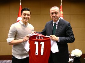 Mesut Ozil was criticised for posing for this photograph with President Erdogan