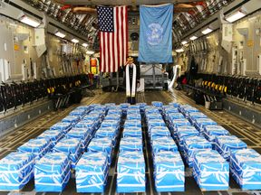 Chaplain U.S. Army Col. Sam Lee performs a blessing of sacrifice and remembrance on the 55 boxes of remains