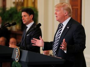 U.S. President Donald Trump and Italy's Prime Minister Giuseppe Conte hold a joint news conference in the East Room of the White House in Washington, U.S., July 30, 2018