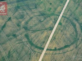 Cropmarks of a large prehistoric enclosure in the Vale of Glamorgan, with the faint footings of a probable Roman villa within. Pic: RCAHMW