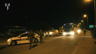 Bus carrying White Helmets