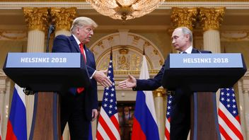 U.S. President Donald Trump and Russia's President Vladimir Putin shake hands during a joint news conference after their meeting in Helsinki, Finland, July 16, 2018