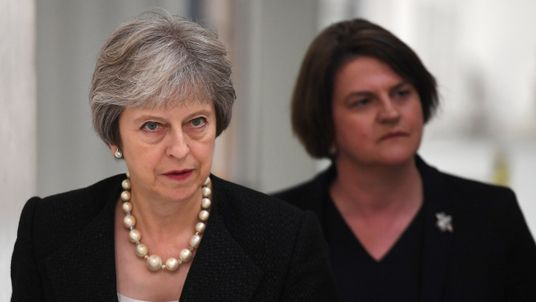 Theresa May and DUP leader Arlene Foster visit a pottery north of the border