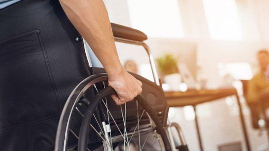 A man sits in a wheelchair