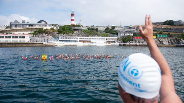 Lewis Pugh waves to swimmers in Plymouth