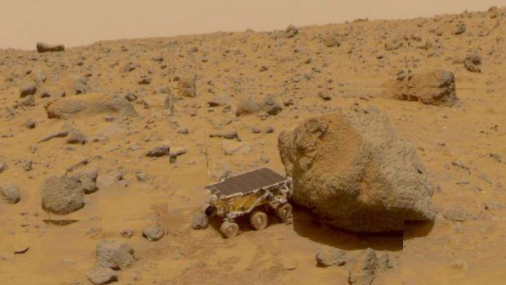 NASA Pathfinder Sojourner Rover robotic data gathering vehicle exploring the surface terrain of the planet Mars