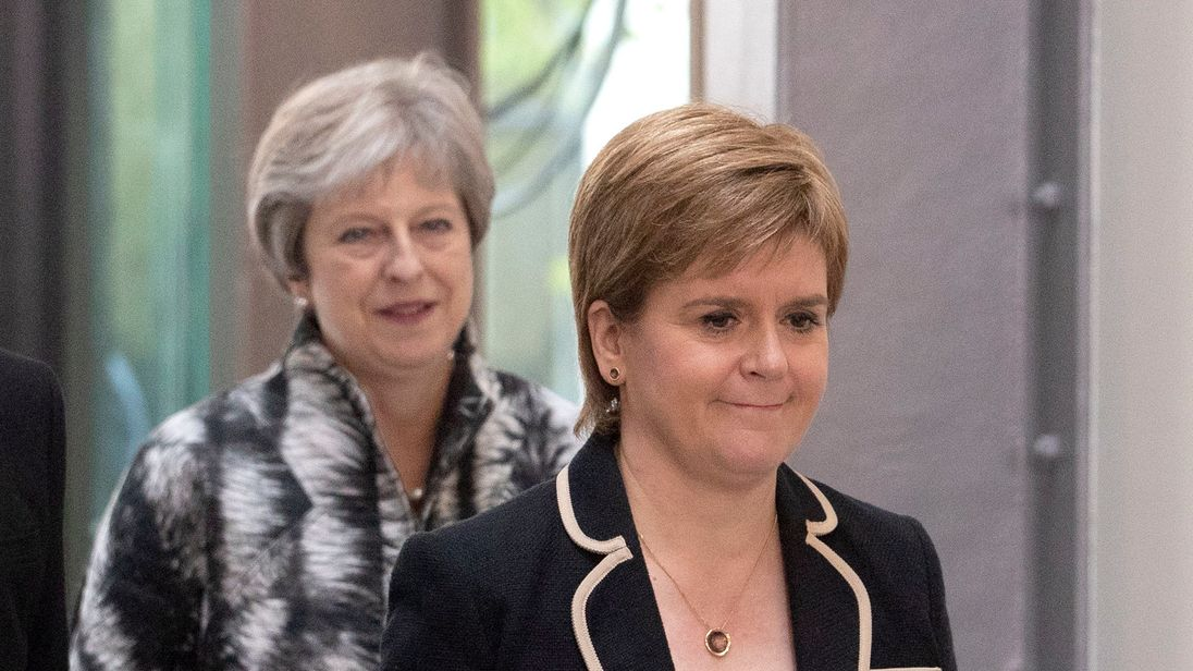 "Theresa May, left, has said Nicola Sturgeon, right, should not try to ""sow the politics of division""."