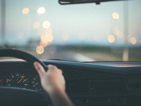 Man driving fast on highway, vintage car interior