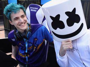 Ninja poses alongside fellow gamer Marshmello during the Epic Games Fortnite E3 Tournament