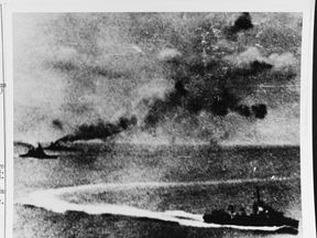 Photograph taken from a Japanese plane, with Prince of Wales at far left and Repulse beyond her. A destroyer, either Express or Electra, is maneuvering in the foreground. Pic: Naval History & Heritage Command