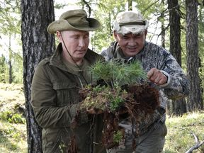 Russia's President Vladimir Putin (L) and Defence Minister Sergei Shoigu are seen during their vacation in Sayano-Shushensky nature reserve in the Republic of Tyva (Tuva Region), Russia August 26, 2018. Picture taken August 26, 2018. Sputnik/Alexei Nikolsky/Kremlin via REUTERS ATTENTION EDITORS - THIS IMAGE WAS PROVIDED BY A THIRD PARTY.