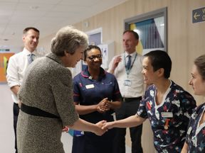 LONDON, ENGLAND - JUNE 18: Britiain's Prime Minister Theresa May and Secretary of State for Health and Social Care Jeremy Hunt meet nurses during a visit to the Royal Free Hospital on June 18, 2018 in London, England. The Prime Minister will today announce a new package of £20 Billion GBP worth of funding for the NHS. (Photo by Dan Kitwood/Getty Images)