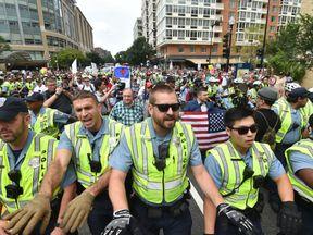 Police escort far-right demonstrators led by 'Unite the Right' organiser Jason Kessler