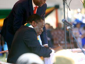 Mr Mnangagwa signs during his inauguration ceremony