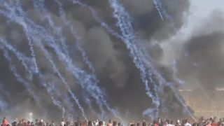 Tear gas canisters rain down over protesters in Gaza