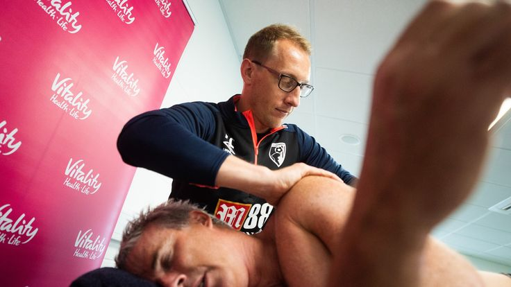 Lewis Pugh receives some help from physiotherapy staff at Bournemouth