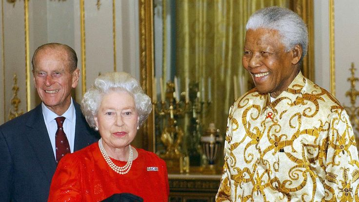 Queen Elizabeth II and the Duke of Edinburgh meet former South African President, Nelson Mandela at Buckingham Palace in 2003