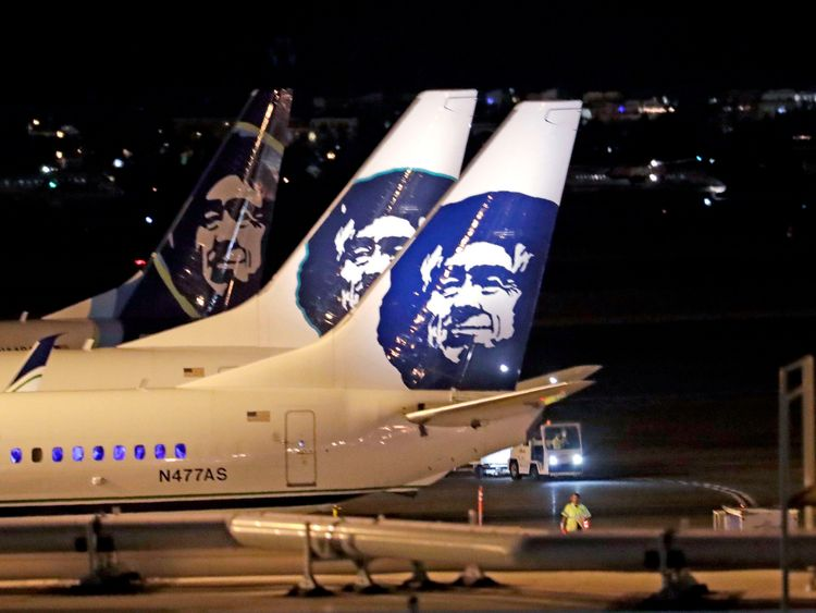 "Alaska Airlines planes sit on the tarmac at Sea-Tac International Airport Friday evening, Aug. 10, 2018, in SeaTac, Wash. Officials at Sea-Tac International Airport say an Alaska Airlines plane that was stolen by an airline employee and has crashed in Washington state. Airport officials said in a tweet Friday night that an airline employee ""conducted an unauthorized takeoff without passengers."" (AP Photo/Elaine Thompson)"
