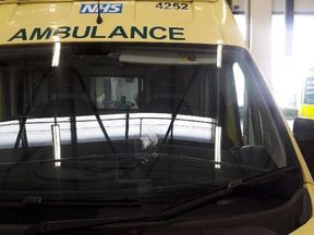 A brick was thrown at an ambulance, leaving this damage on the windscreen. Pic: West Midlands Ambulance Service