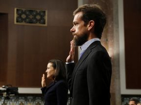 Social media executives are sworn in to testify before U.S. Senate Intelligence Committee on Capitol...