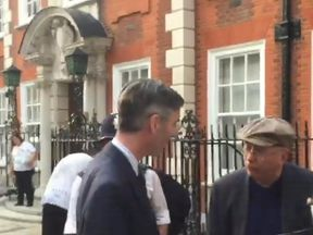 Jacob Rees-Mogg speaks with Class War activist Ian Bone outside his Westminster home