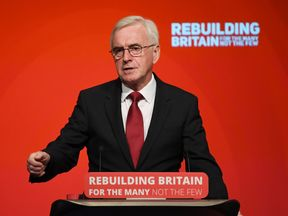 Shadow Chancellor John McDonnell addresses delegates on the second day of the Labour Party Conference in Liverpool