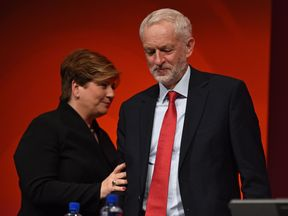 Shadow Foreign Secretary Emily Thornberry (L), touches the arm ofJeremy Corbyn, as she returns to her seat after speaking to delegates at the Labour party conference