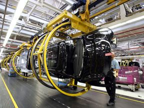 The production line at the BMW UK Mini plant in Oxford