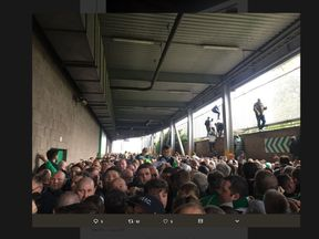 The scene outside the Old Firm derby, with people forced to climb over walls. Pic: @Hoidy