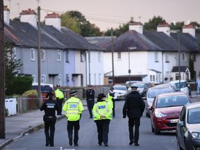 Police stand guard during a police raid in Sunbury, Surrey near London on September 16, 2017. British police raided a home near London on September 16, just hours after making their first arrest in the investigation into the bombing of an Underground train a day earlier. / AFP PHOTO / Chris J Ratcliffe (Photo credit should read CHRIS J RATCLIFFE/AFP/Getty Images)